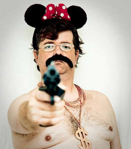 About a Man, a Mouse, a Gun, a Moustache, Some Gold Chains, a Pair of Glasses, and a Polkadot Bow...